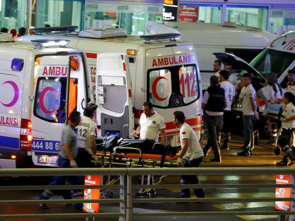 Paramedics push a stretcher at Turkey's largest airport, Istanbul Ataturk, Turkey, following a blast June 28, 2016.